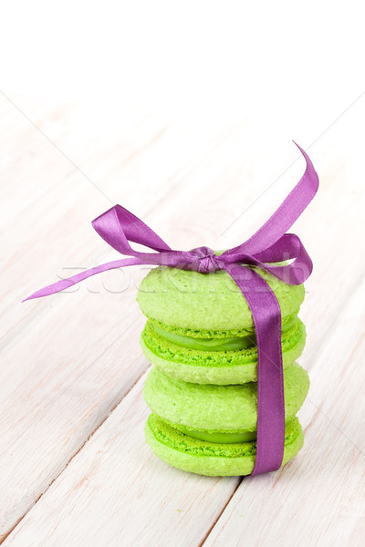 Green macarons with purple ribbon Stock photo © karandaev