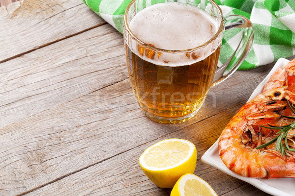 Stock photo: Beer mug and grilled shrimps