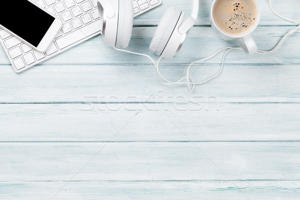 Headphones, phone and pc on wooden desk table Stock photo © karandaev