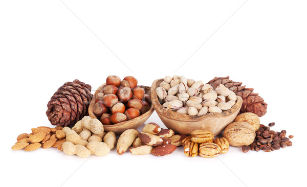 Stock photo: Various nuts. Isolated