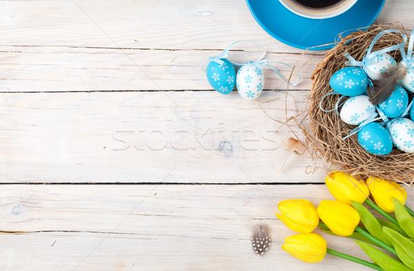 Foto stock: Páscoa · azul · branco · ovos · ninho · amarelo