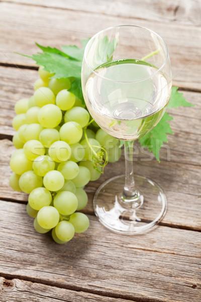 Wine glass and grapes Stock photo © karandaev