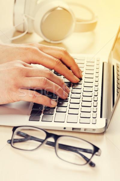 Woman working on laptop. Hands typing on keyboard. Stock photo © karandaev