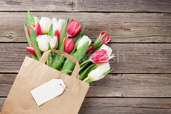 Színes tulipánok papírzacskó fából készült piros fehér Stock fotó © karandaev