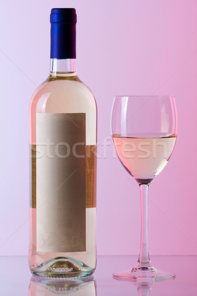Bottle of white wine and wine glass in red gamma Stock photo © karandaev
