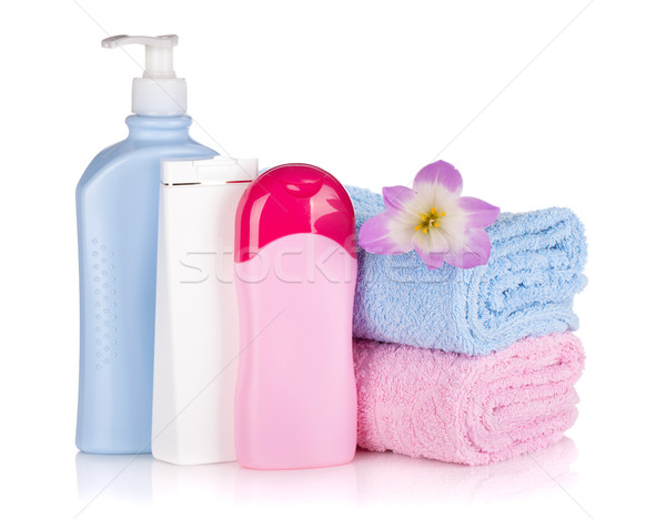 Shampoo and gel bottles with towels and flower Stock photo © karandaev