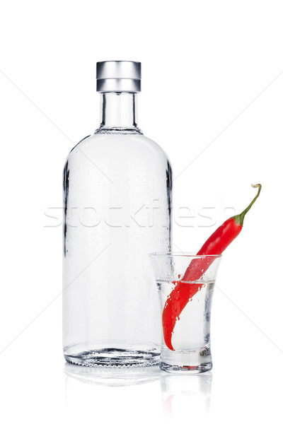 Bottle of vodka and shot glass with red chili pepper Stock photo © karandaev