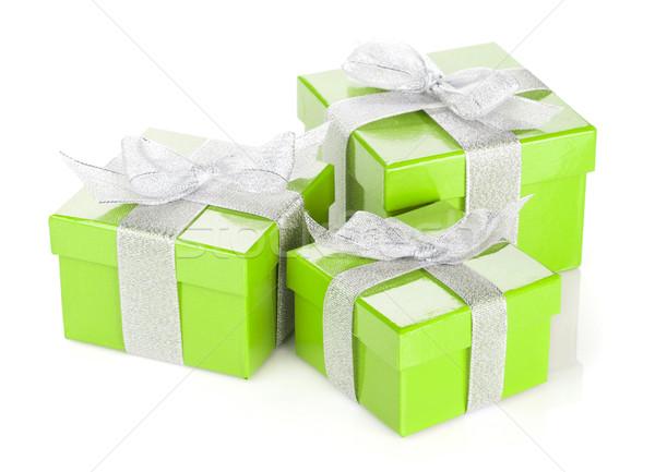 Three green gift boxes with silver ribbon and bow Stock photo © karandaev