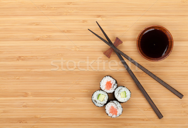 Sushi ingesteld eetstokjes sojasaus bamboe tabel Stockfoto © karandaev