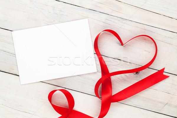 Photo frame or greeting card and valentines heart shaped ribbon Stock photo © karandaev