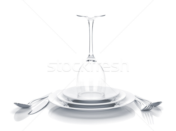 Silverware or flatware set and wine glass over plates Stock photo © karandaev