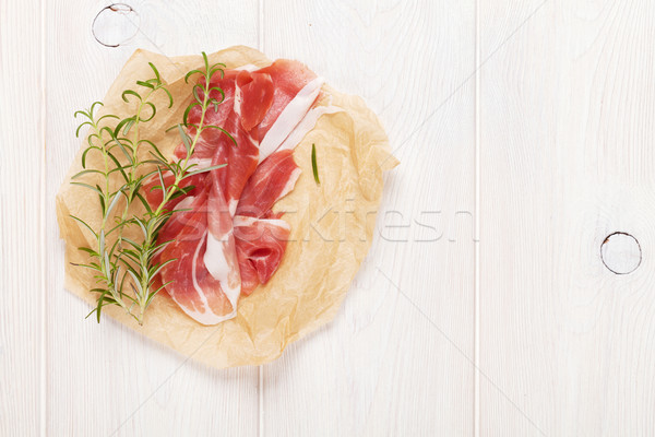 Prosciutto with rosemary Stock photo © karandaev