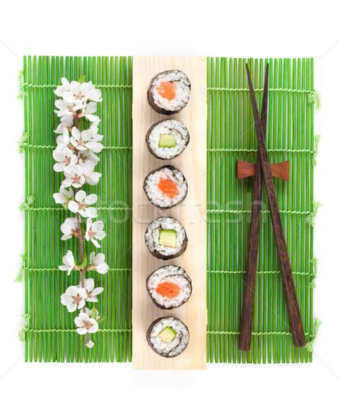 Sushi maki set with salmon and cucumber and sakura branch Stock photo © karandaev