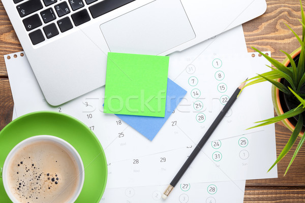 Office desk table with computer, supplies, flower and coffee cup Stock photo © karandaev