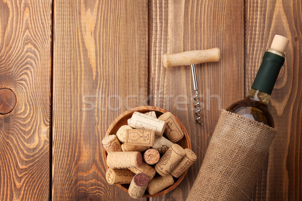 White wine bottle, corks and corkscrew Stock photo © karandaev