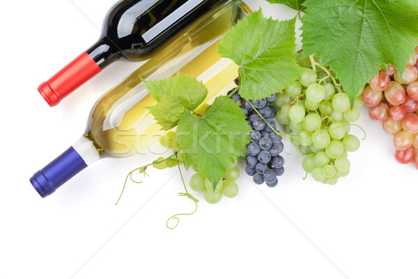 Bunch of grapes and wine bottles Stock photo © karandaev