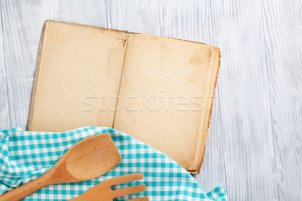 Kitchen table with cooking book and utensils Stock photo © karandaev