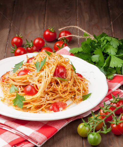 Spaghetti pasta tomaten peterselie houten tafel Stockfoto © karandaev
