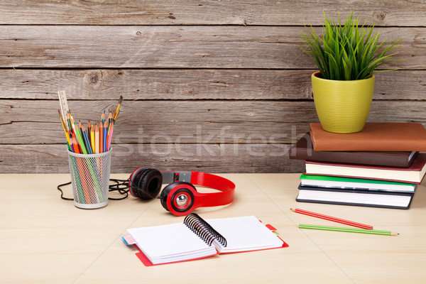Stock photo: Office desk with supplies, headphones and plant