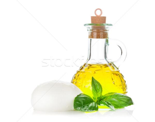 Mozzarella cheese, olive oil and basil Stock photo © karandaev
