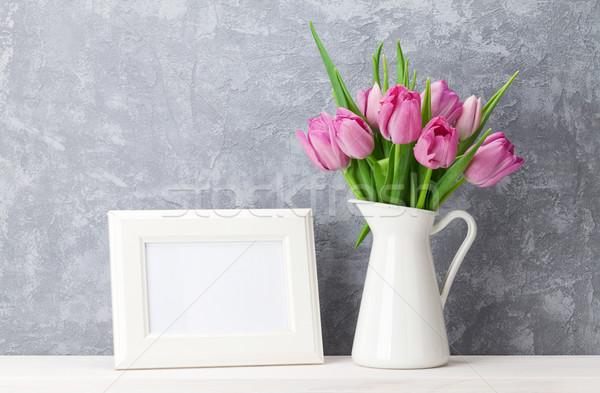 Fresh pink tulips bouquet and photo frame Stock photo © karandaev