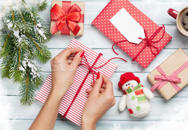 Female hands wrapping christmas gift Stock photo © karandaev