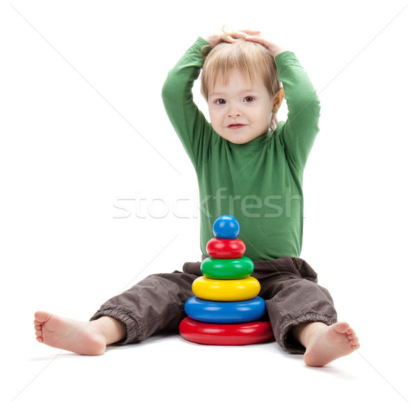 Small baby with a toy pyramid Stock photo © karandaev