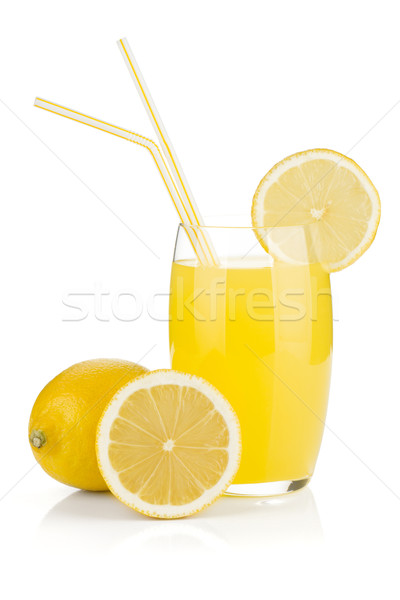 Stock photo: Lemon juice glass and fresh lemons