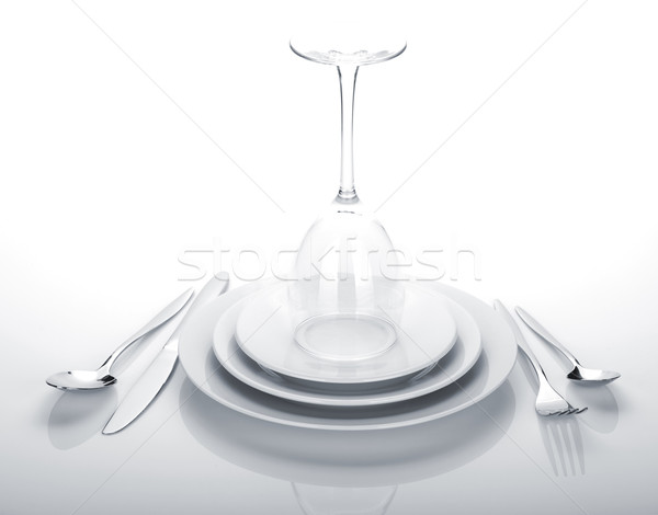 Silverware or flatware set and wine glass over plates Stock photo © karandaev