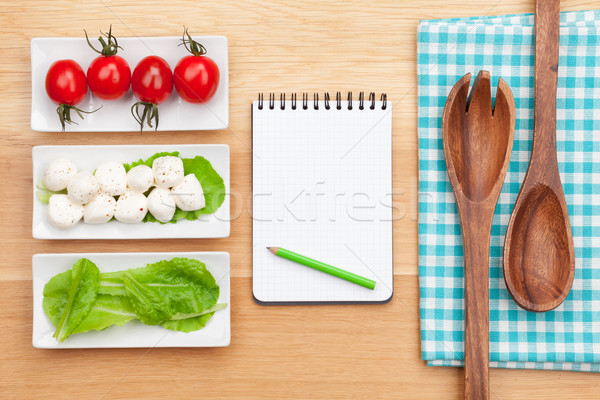 Stock photo: Fresh healthy salad, tomatoes, mozzarella and notepad for copy s