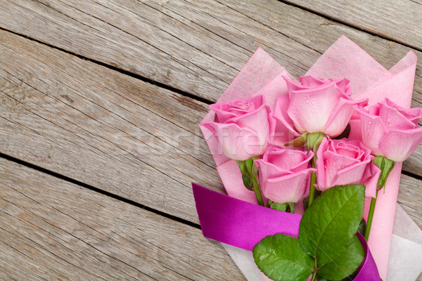 Stock photo: Garden pink roses bouquet over wooden table