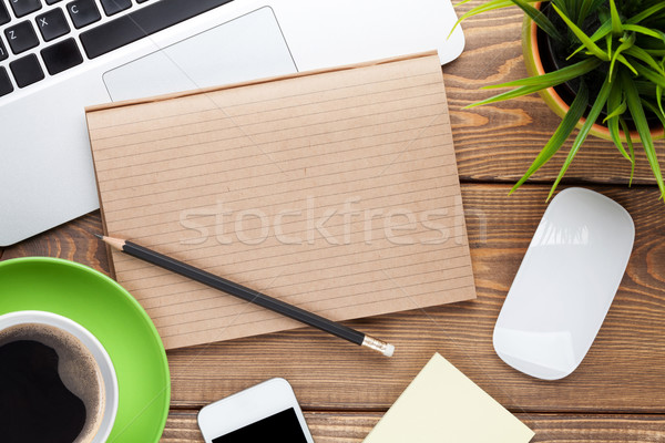Office desk table with computer, supplies, coffee cup and flower Stock photo © karandaev