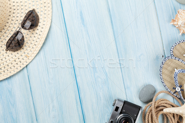 Travel and vacation items on wooden table Stock photo © karandaev