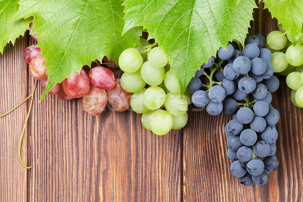 Bunch of grapes on wooden background Stock photo © karandaev