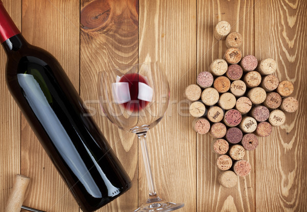Red wine bottle glass and grape shaped corks Stock photo © karandaev
