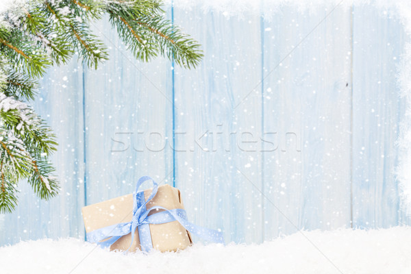 Christmas gift box and fir tree branch in snow Stock photo © karandaev