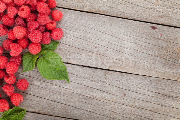 Stock photo: Fresh ripe raspberries on wooden table
