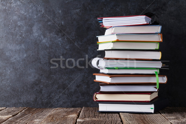 Notepads on school table in front of chalk board Stock photo © karandaev