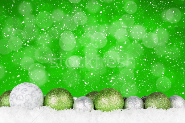 Christmas background with baubles and bokeh Stock photo © karandaev