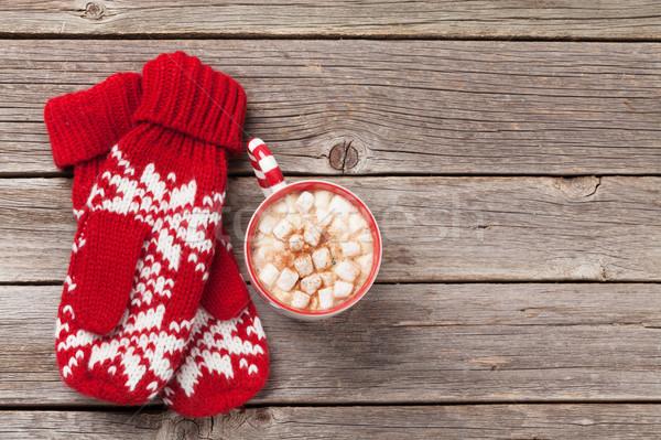 Karácsony ujjatlan kesztyűk forró csokoládé mályvacukor fa asztal felső Stock fotó © karandaev
