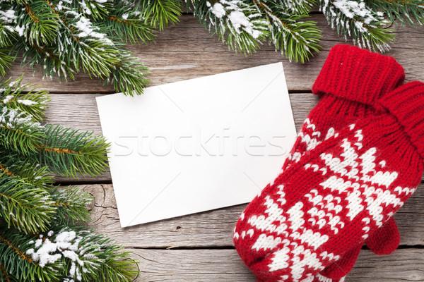 Karácsony üdvözlőlap fenyőfa ujjatlan kesztyűk fa asztal felső Stock fotó © karandaev