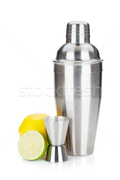 Cocktail shaker with measuring cup and citruses Stock photo © karandaev