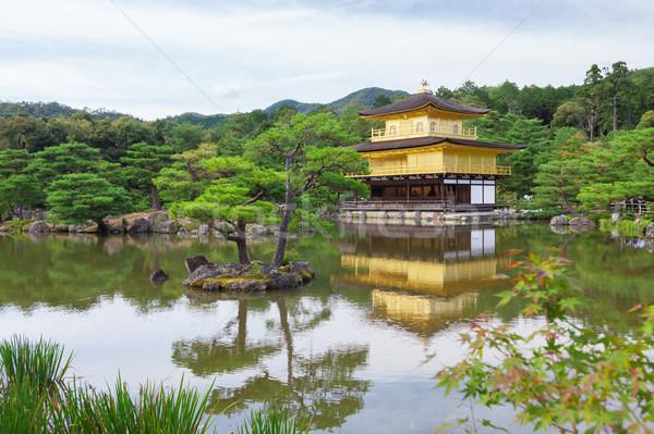 Dourado templo quioto água árvore edifício Foto stock © karandaev