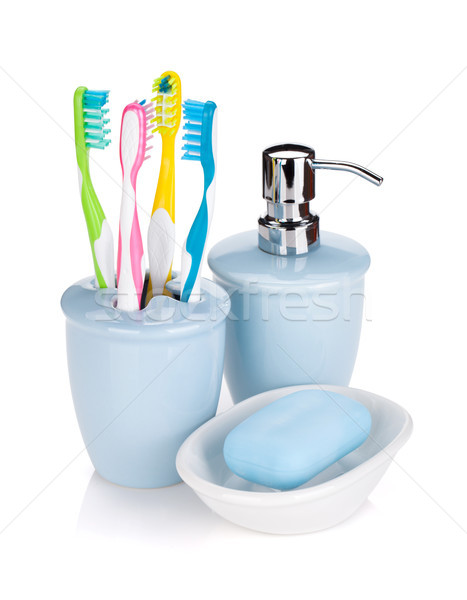 Four colorful toothbrushes and soap Stock photo © karandaev