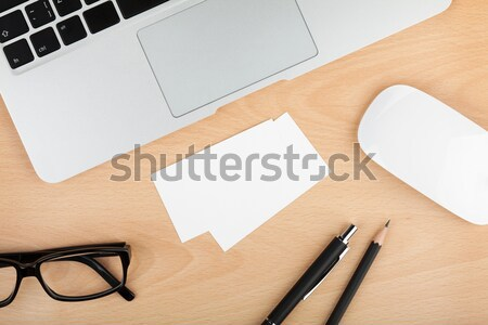 Blank business cards on wooden office table Stock photo © karandaev