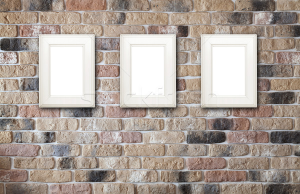 Photo frames on brick wall Stock photo © karandaev