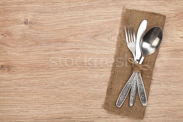 Ezüst étkészlet szett villa kanál kés fa asztal Stock fotó © karandaev