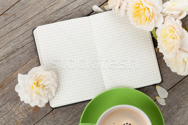 Blank notepad, coffee cup and white rose flowers Stock photo © karandaev