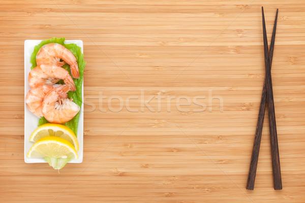 Pişmiş limon Çin yemek çubukları ahşap masa bo Stok fotoğraf © karandaev