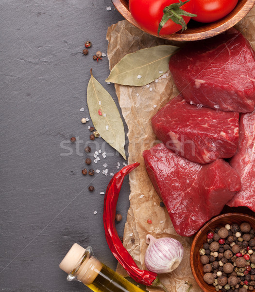 Stock photo: Raw fillet beef steak and spices on stone board
